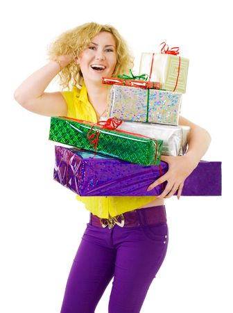 Woman standing and holding many gifts photo