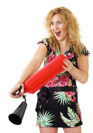 extinguish: blond woman extinguish fire using fire extinguisher Stock Photo