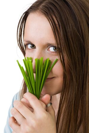 Smiling woman with green onion cooking healthy diner Stock Photo - 5072085