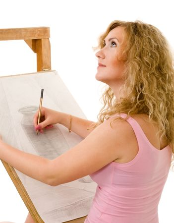 blond woman drawing in pencil using easel photo