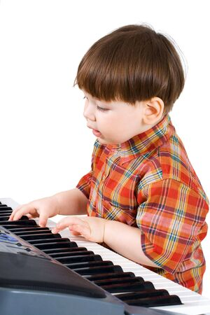 stu: young toddler stu to play music on piano Stock Photo
