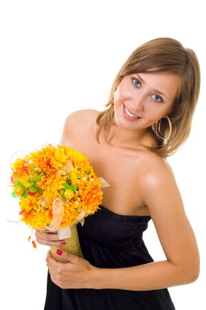 Gorgeous young woman with bunch of autumn flowers photo