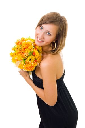 Woman posing with gold color flowers side view looking at camera photo