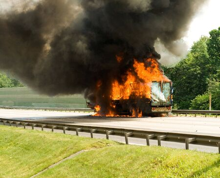 cargo loss in track engulfed by fire with black smoke photo