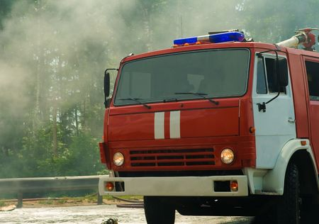 fire engine on the fire with smoke on background photo