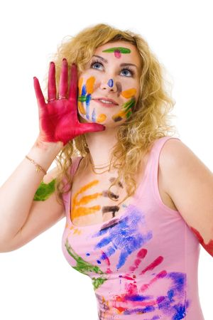 Creative young woman painter with painted face skin and clothes photo