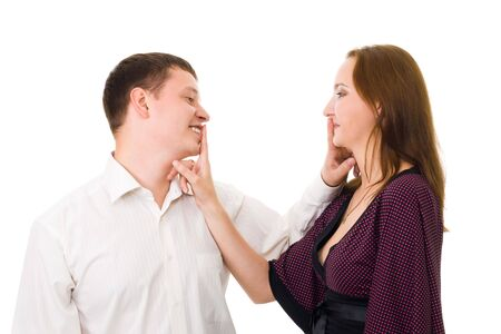 Positive couple  make hush sight with finger standing in profile isolated on white photo