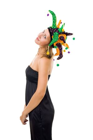 jester hat: Young woman stand wearing jester hat and black one-piece suit standing in profile and smile