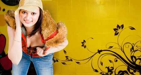 hip hop girl standing with graffiti on background Stock Photo - 5308732