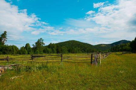 urals: rural panorama with Urals mountains on background and clear sky