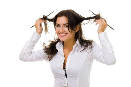 One young woman twirl her hair with sticks in white shirt smiling and looking at camera Stock Photo - 5372172