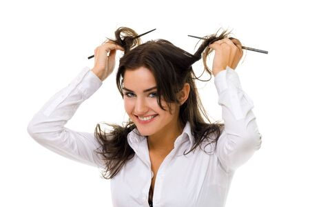 One young woman twirl her hair with sticks in white shirt smiling and looking at camera Stock Photo - 5383632