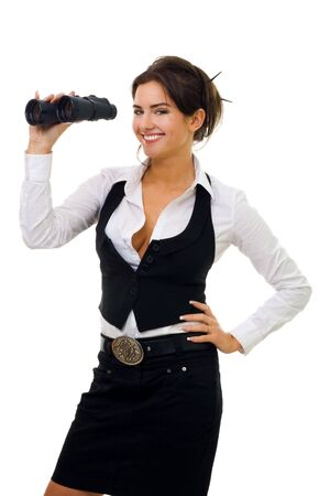 Young woman standing and looking into binocular with big smile photo