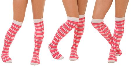 Pairs of women legs in color pink socks standing in different poses isolated on white photo