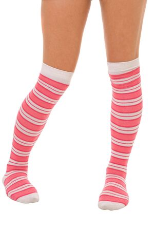 woman legs in color pink socks isolated on white photo
