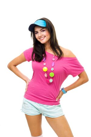 peaked: Woman in pink t-shirt and blue peaked cap smiling have fun standing in front view isolated on white Stock Photo