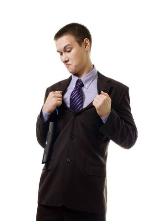 oppress: Young man in formal suit tear it apart because it is wrong size or it stifle him, isolated on white