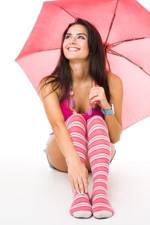 calcetines: Happy young woman in pink sesi�n con paraguas aisladas en blanco