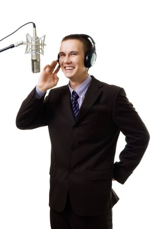 Man host at radio station speak to microphone wearing suit,isolated on white Stock Photo - 5445930