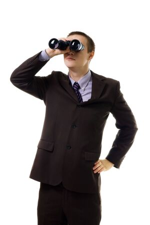 Man in formal suit look into binoculars,isolated on white Stock Photo - 5445908