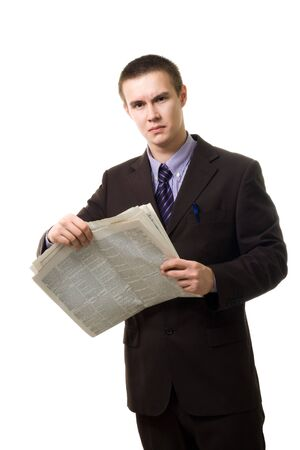 pressman: Confident young man reading newspaper standing and wearnig suit isolated on white
