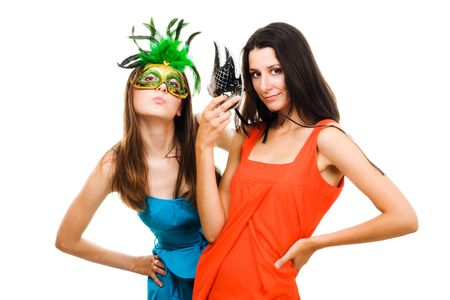 Two women in masks and color dresses flirting,isolated on white photo