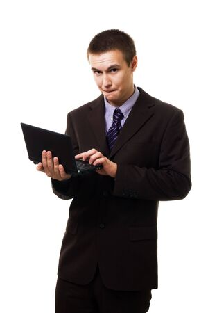 Young business man work hard,stand with laptop,isolated on white photo