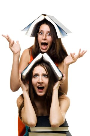 Two crazy shocked woman just accepted to university,isolated on white Stock Photo