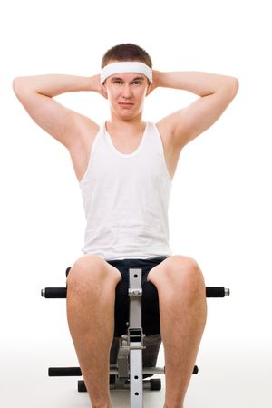 Young man do fitness exercise on bench isolated on white photo