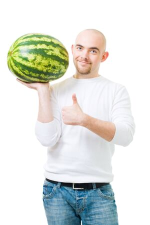 heaviness: Positive bold man in white with watermelon and thumb up,isolated Stock Photo