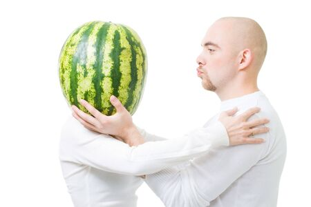 foolishness: Bold young man kissing woman with head made of watermelon