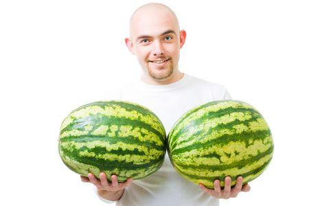 heaviness: Young happy bold man with two watermelons fruit show double success,isolated on white Stock Photo