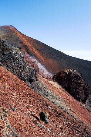 volcano slope: slope of volcano with red voulcanic rock soil