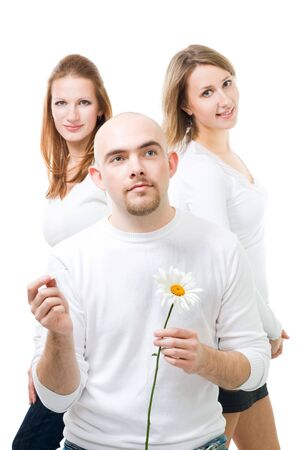 amity: Happy young man think and hold with camomile with two women on background