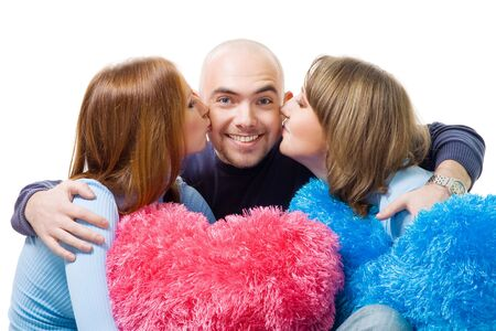 hot love: Two girls kiss happy young bold smile man in cheek holding color hearts,isolated on white Stock Photo