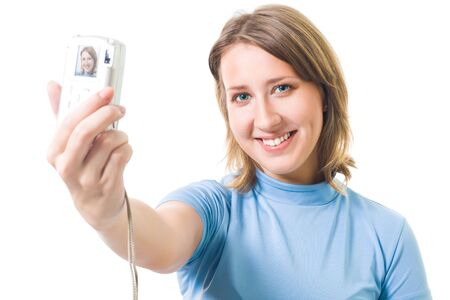 Self portrait - young woman with big smile shoot herself with digital camera photo