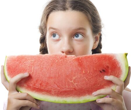 Young teenager girl look with watermelon piece,isolated on white photo