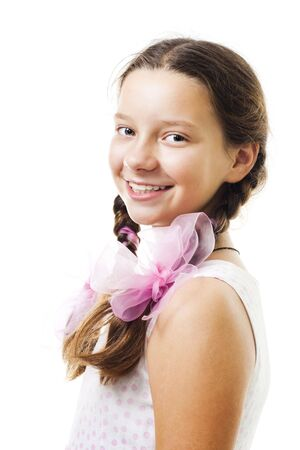 Portrait of teenager girl smile and look at camera in pink,isolated on white Stock Photo - 5669671