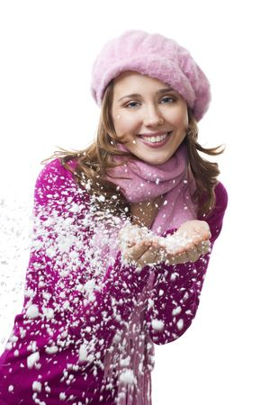Woman blow snowflakes from hands and smile,isolated on white photo