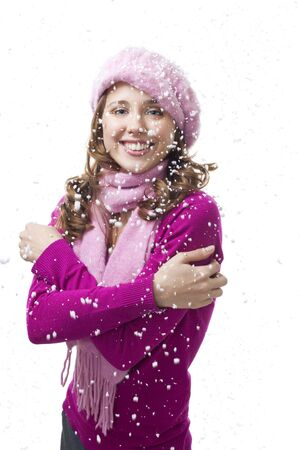 Happy young woman stand with snowflakes falling, isolated on white photo