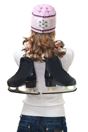 Woman going to skate holding ice skates behind the back,isolated on white photo