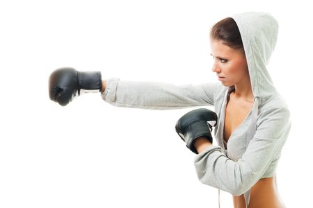 Conident strong woman hit the goal with right hand, boxing, profile view,isolated Stock Photo