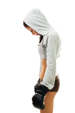 Sad woman loss the fight in boxing, stand and hang her head, isolated on white photo