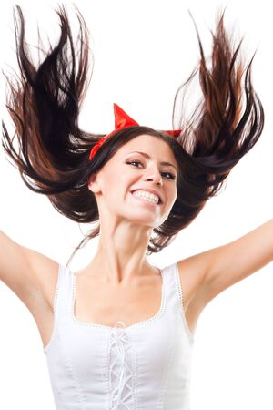 Positive woman falling with her hair fly, isolated on white photo