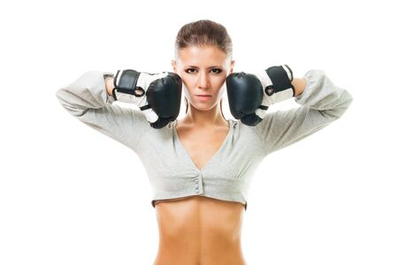 female boxer: Confident woman in boxing gloves and with triumphant look,isolated on white