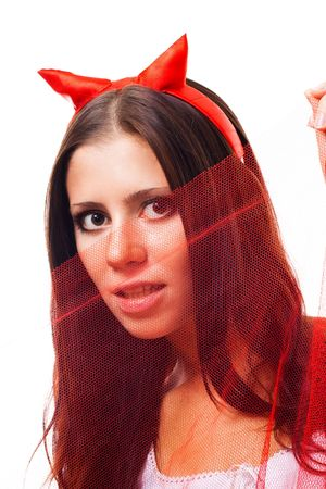 Woman with horns flirting hiding playing and hiding behid piece of cloth Stock Photo - 5841427
