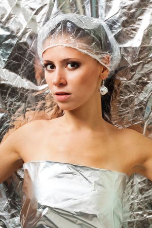 Beautiful futuristic woman in silver foil dress on reflective background Stock Photo - 5841430