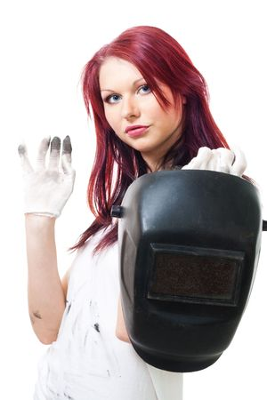 Woman in dirty gloves hold welder photo