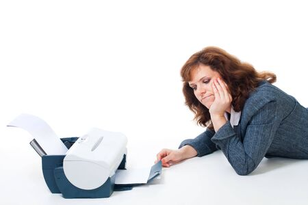 tedious: Woman tired to wait until printer print document, isolated on white Stock Photo