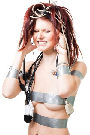 Woman have head ache caused by electronics and electric wires Stock Photo - 6066296